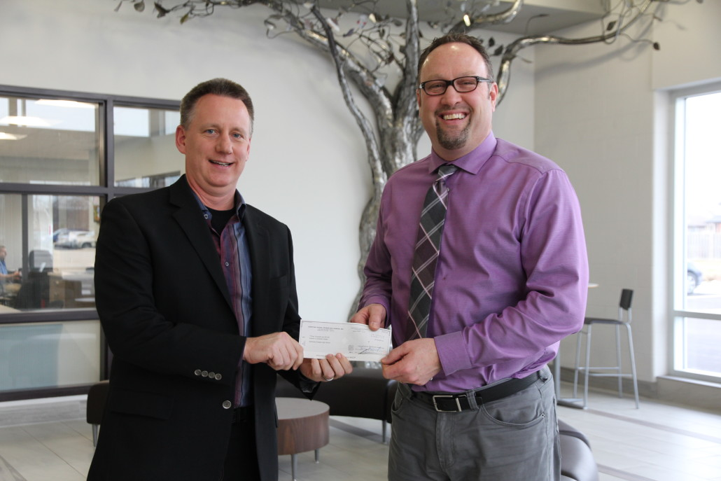 Photo caption: Christian School Foundation board member Kevin Antonides, left, presents Smithville Christian High School principal Ted Harris with a cheque for $30,000 – a donation to the school's recent In Motion campaign and to the school's bursary fund – made with a gift of securities.